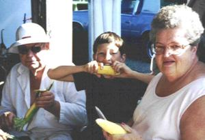 Mom, Dad, Chris eating corn on cob.
