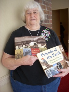 Author Pat McCarthy holding her books.