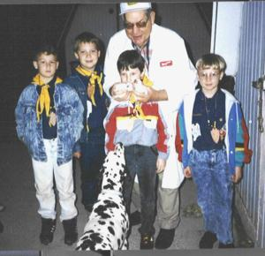 Dad shares Dalmatians with Chris and Boy Scout friends.