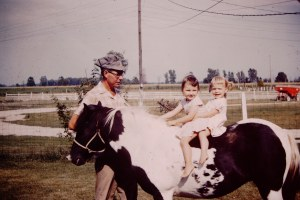 It's no wonder I love horses--Dad had my sister and me on one at an early age.