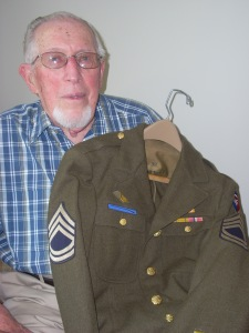 WWII vet Richard Beitler holds the uniform he wore 70 years ago.