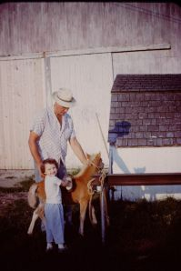 Dad teaching me to brush a colt. Look at my happy face!