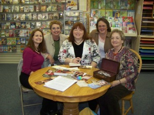 Meeting famous authors like Tracie Petersen offers chance to ask writing questions. Tracie is in middle.