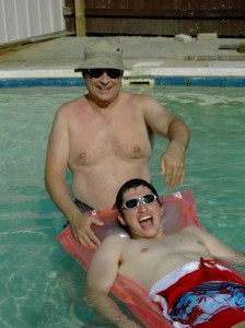 My husband and son frolicking in a pool.