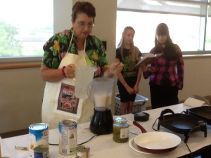 Preparing the pina colada recipe from my Now You're Cooking: Cuba cookbook.