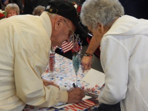 WWII vets signed copies of WWII Legacies which they were featured in.