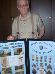 WWII vet George Buhler displays his medals earned during military service in Europe.