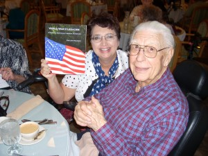 Richard Vanderwall being presented with his copy of my book which includes his WWII story.