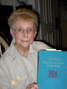 British-born Dorothy Blue holds book about Winston Churchill which mentions her military service during WWII.